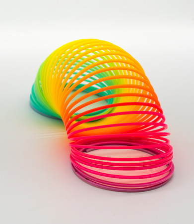 Photo for Rainbow Slinky spring toy isolated on white background. - Royalty Free Image