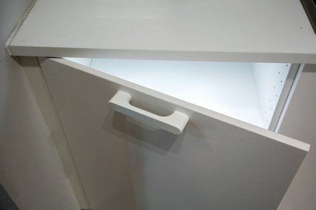 Small white cabinet with LED lighting inside. Automatic illuminated system door when opened.