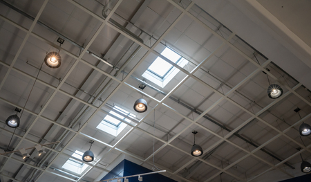 Photo for Light lamp ceiling under roof and sky light in warehouse. - Royalty Free Image