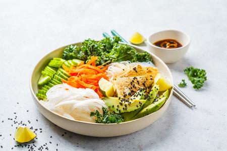 Photo pour Vegan bun cha salad bowl with sticky tofu, rice noodles and vegetables. Plant based diet concept. - image libre de droit