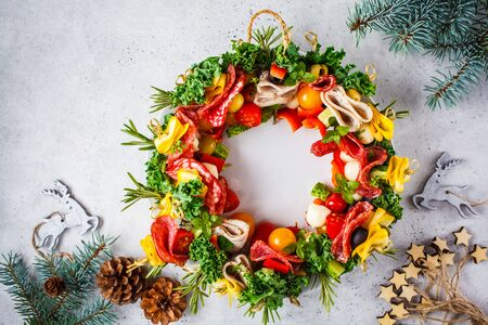 Photo pour Christmas food background. Christmas wreath of holiday appetizer, white background, top view. - image libre de droit