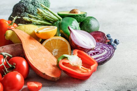 Photo for Rainbow colors fresh vegetables and berry background. Detox, vegan food, ingredients for juice and salad. - Royalty Free Image