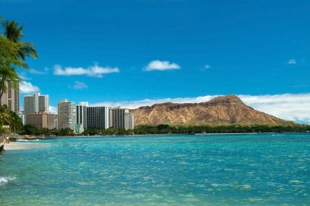 Waikiki beach with azure water in Hawaii with Diamond Head in background