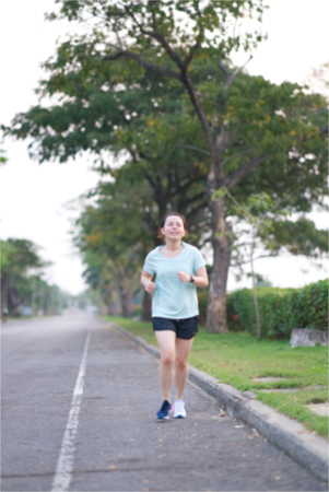 Blur photo of Asian runner is running along traffic street way in the morning