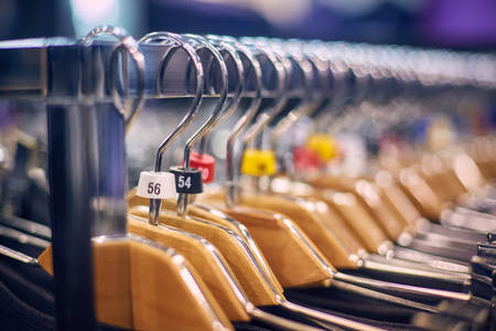 Showcase with mens trousers on hangers in a mens store