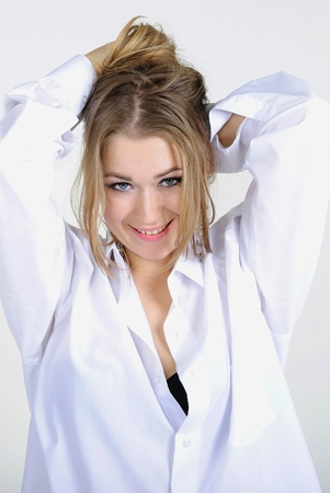 The young beautiful girl in a white shirt