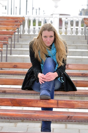 The young beautiful girl on a bench