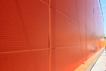 Wall of city shopping center in orange color