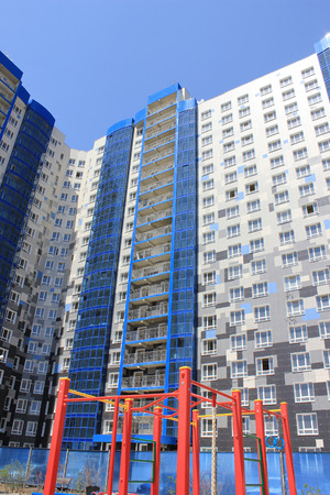 The new house revetted with a multicolored granite tile in the city of Volgograd