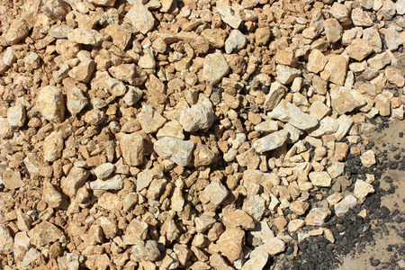 Yellow gravel for laying of asphalt roads and filling of emptiness