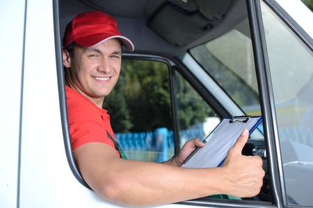 Foto de Postal service. Delivery of a package through a delivery service - Imagen libre de derechos