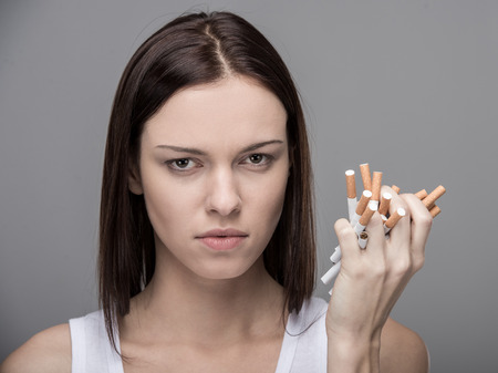 Young woman with many cigarettes.Concept of quit smoking.