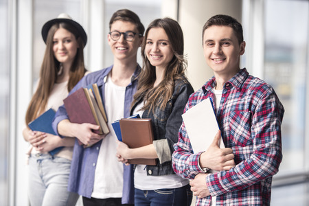 Photo for Group of happy young students in a university. - Royalty Free Image