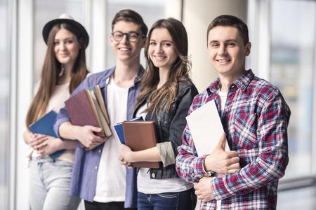 Photo pour Group of happy young students in a university. - image libre de droit
