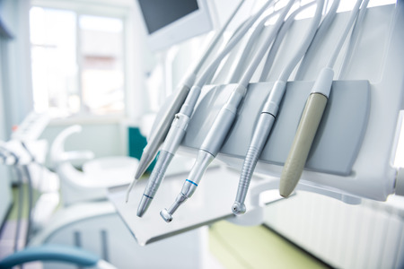 Photo pour Different dental instruments and tools in a dentists office - image libre de droit