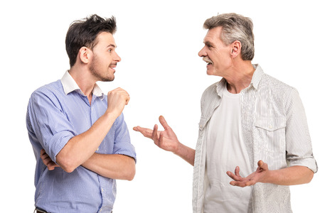 Photo pour Senior father with adult son talking, isolated white . - image libre de droit