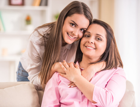 Photo for A happy family. Mother and teen daughter at home. - Royalty Free Image