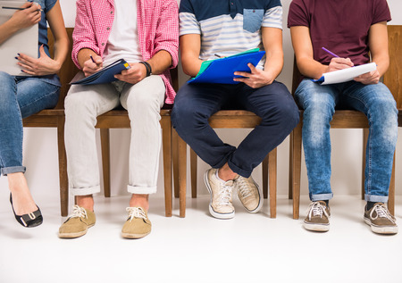 Photo for Group of people sitting on chairs waiting interviews - Royalty Free Image