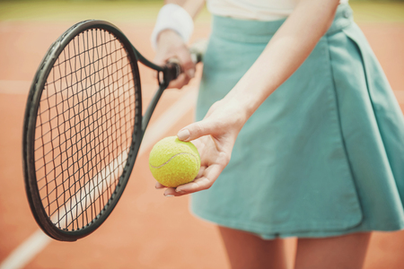Close up. Girl on Tennis Court with Racket ready to Pitch.Recreation Concept. Sport Concept. Active Leisure in Summer. Sport Game. Healthy Hobby. Ready to Serve. Outdoor Recreation.