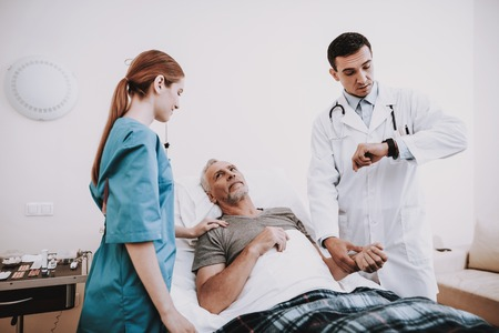 Help Doctor. Rehabilitation Patient. Body Patient. People in White Room. Rehab Patient. Old Man and Doctor in Hospital. Old Man and Nurse. Body in Hospital. Professional Doctor with Nurse Help Patient