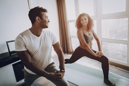 Afro American Couple. Morning Exercises Concept. Gym Carpets. Work Out Together. Healthy Lifestyle. Shape Sportswear. Attractive Athlete. Physical Healthcare. Body Moving. Home Fitness.