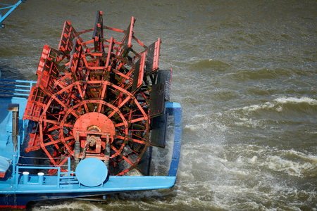 Red paddle wheel on streamship.