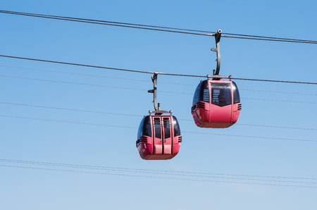 Cabins of a cable car over the Ural River. The picture was taken in Russia, in the city of Orenburg. 04/17/2018
