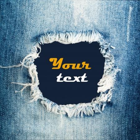 Foto de Blue torn denim jeans texture with space for text - Imagen libre de derechos