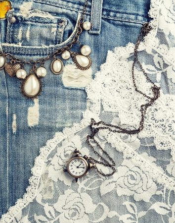 retro background with vintage jewelry and jeans texture