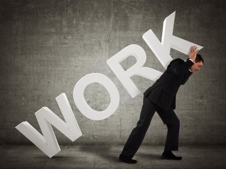 Photo pour Businessman carries the word Work - image libre de droit