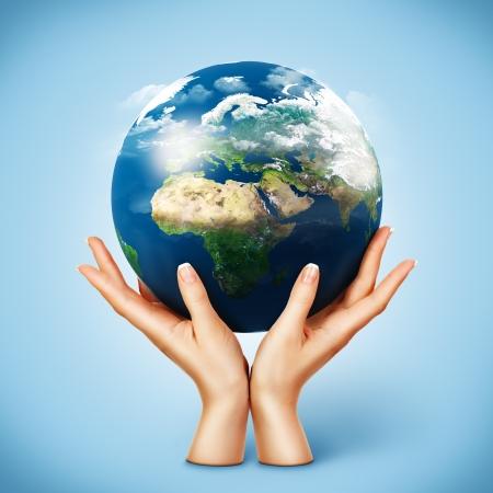 Globe in women's hands. Planet