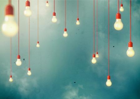 Photo of Hanging light bulbs with depth of field  Modern art