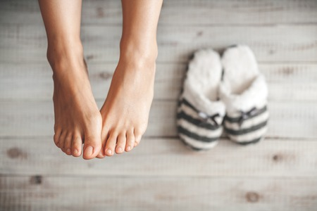 Soft photo of woman's feet with slippers, top view pointの写真素材