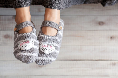 Soft photo of woman feet in cute slippers, top view point