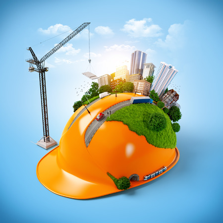 Photo for City on the construction helmet. Unusual construction concept - Royalty Free Image