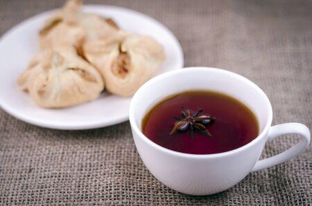 Photo pour Black tea with anise and pastries - image libre de droit