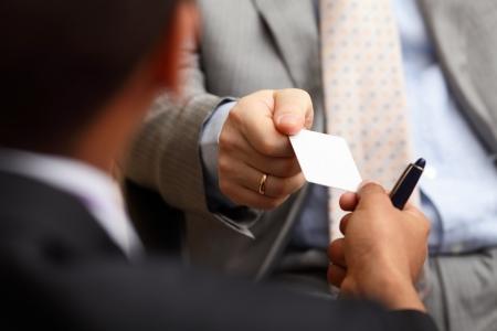Photo pour Closeup portrait of two successful business executive exchanging business card - image libre de droit