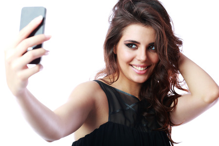 Happy woman taking self picture with smartphone camera