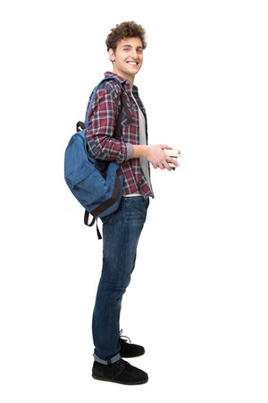 Photo for Full length portrait of a happy male student over white background - Royalty Free Image