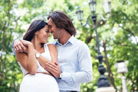 Happy beautiful couple having fun outdoors in park