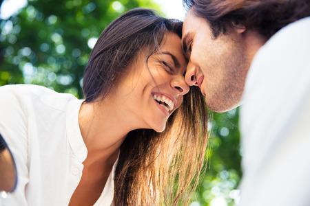 Photo pour Cheerful romantic couple outdoors - image libre de droit