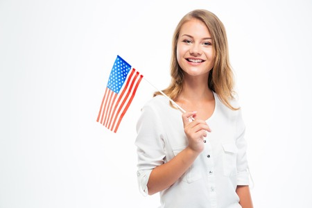 Happy young girl holding USA flag isolated on a white background