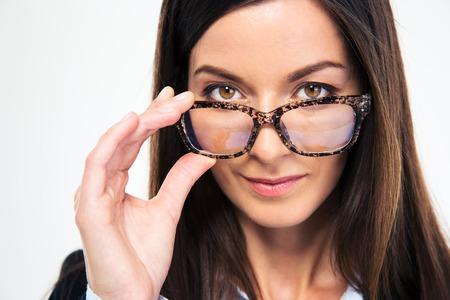 Photo pour Closeup portrait of a businesswoman holding glasses and looking at camera - image libre de droit