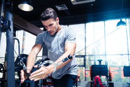 Photo for Portrait of a fitness man workout in gym - Royalty Free Image