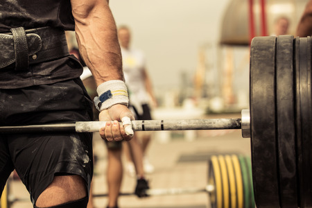 Foto de Closeup portrait of professional bodybuilder workout with barbell outdoors - Imagen libre de derechos