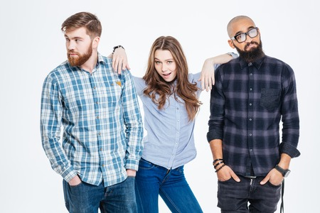 Photo for Beautiful confident young woman standing between two bearded pensive young men - Royalty Free Image