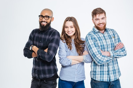 Photo for Multiethnic group of three confident smiling students standing - Royalty Free Image
