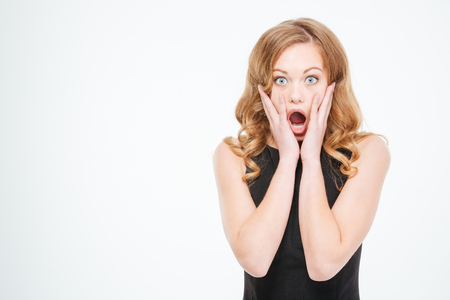 Photo pour Amazed woman looking at camera isolated on a white background - image libre de droit
