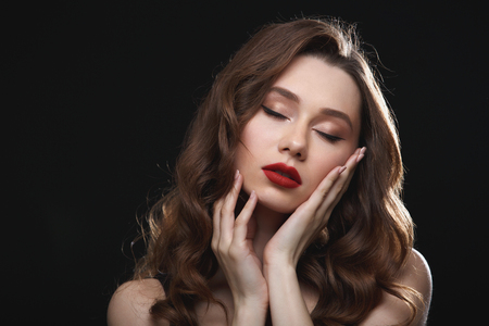 Tender attractive young woman with red lips and closed eyes