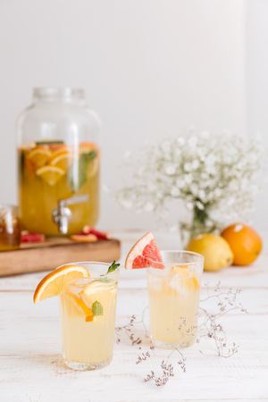 Croopped image of citrus beverage on table